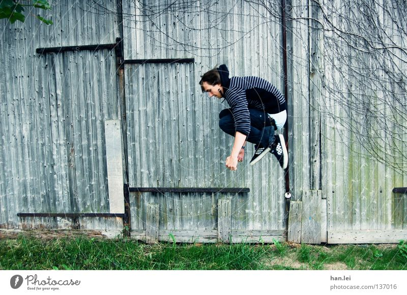 Youth (Young adults) Joy Meadow Wall (building) Wood Movement Jump Style Air Footwear Power Leisure and hobbies Flying Masculine Posture Pants