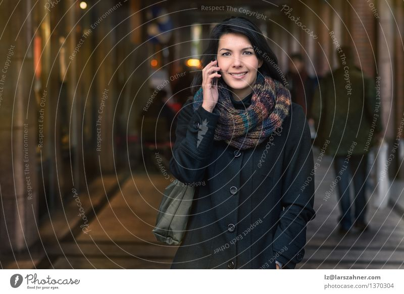 Smiling Woman in Autumn Fashion Talking on Phone Lifestyle Happy Beautiful Face Winter To talk Telephone PDA Adults 1 Human being 30 - 45 years Town Street Coat