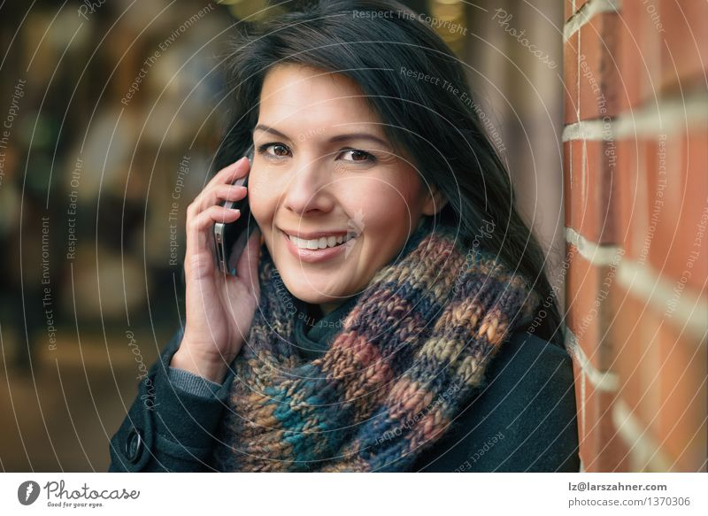Smiling Woman in Autumn Fashion Talking on Phone Lifestyle Happy Beautiful Face Winter To talk Telephone PDA Adults Town Street Coat Scarf Brunette Happiness