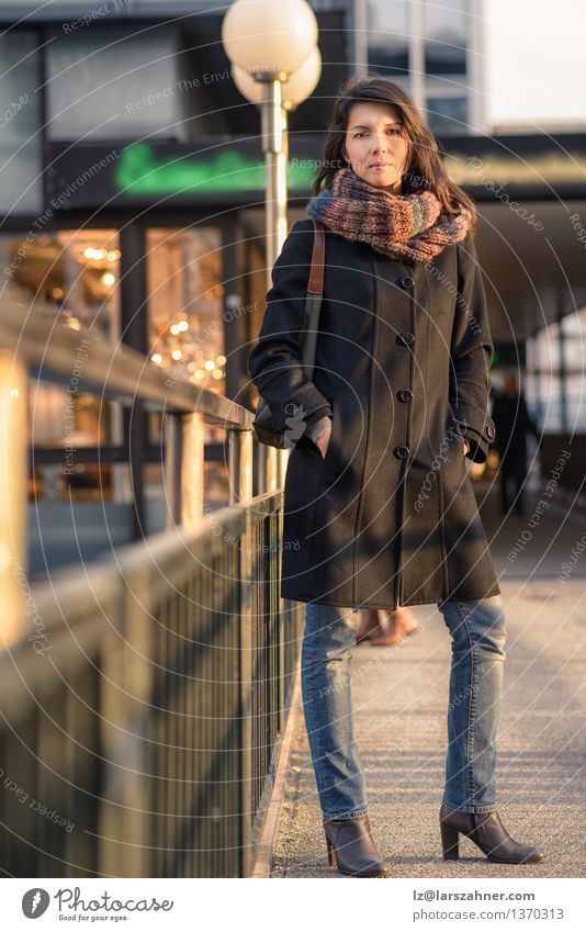 Stylish Pretty Woman Leaning on Pathway Rails Lifestyle Beautiful Vacation & Travel Sun Adults 1 Human being 30 - 45 years Autumn Town Fashion Jeans Coat Scarf