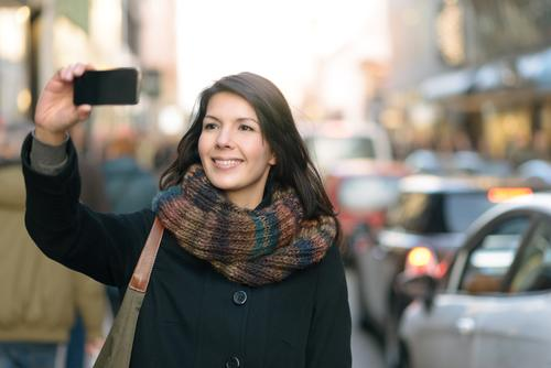Stylish Woman Taking Selfie at the City Street Lifestyle Style Joy Happy Face Vacation & Travel Tourism Winter Telephone Cellphone PDA Camera Technology Adults