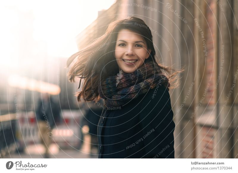 Happy woman with a lovely smile on a winter street Human being Woman Nature City Sun Joy Winter Face Adults Street Autumn Movement Lifestyle Freedom Fashion