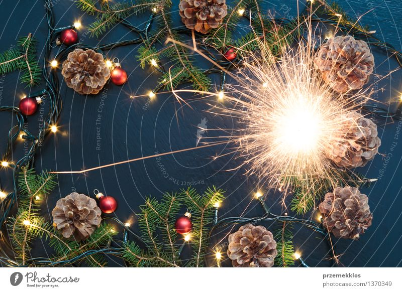 Christmas decoration with sparkler, lights and pine twigs Christmas & Advent Background picture Feasts & Celebrations Decoration Twig Tradition Story Home Pine Glitter Ball Horizontal December Spark Holiday season Sparkler Christmas fairy lights