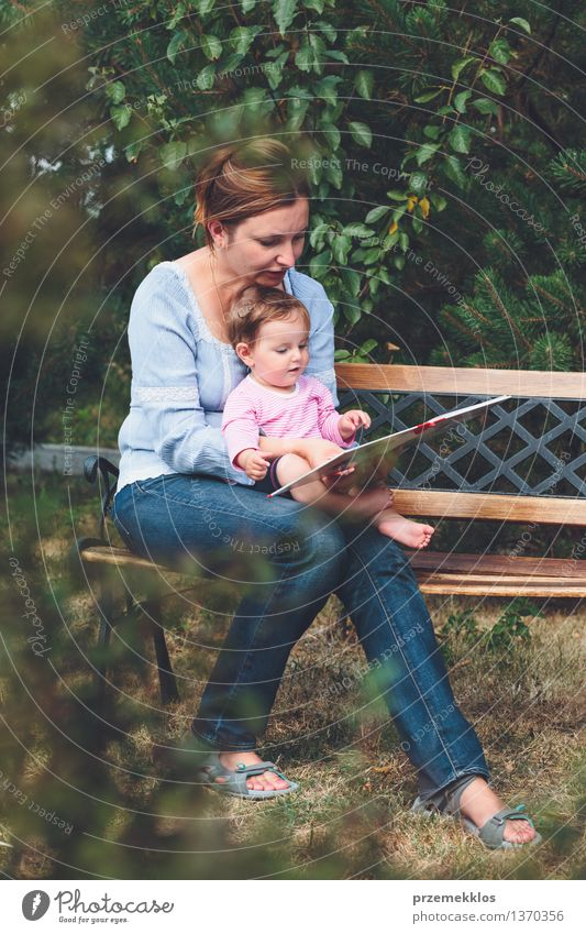 Mom reading a book her little daughter Lifestyle Joy Happy Beautiful Playing Reading Garden Child Baby Toddler Girl Woman Adults Parents Mother