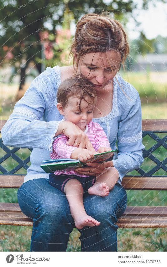 Mom reading a book her little daughter Human being Woman Child Beautiful Joy Girl Adults Life Love Playing Happy Family & Relations Small Garden Lifestyle Park