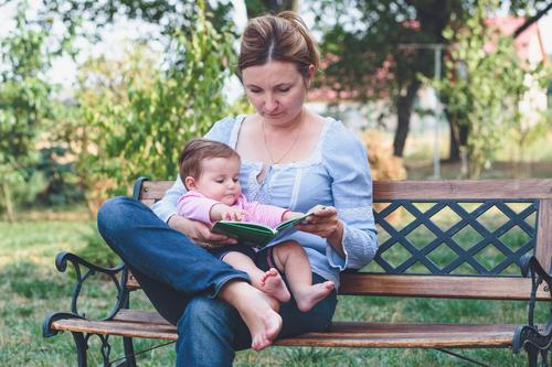 Mom reading a book her little daughter Woman Child Beautiful Joy Girl Adults Life Love Happy Family & Relations Small Garden Lifestyle Park Infancy Smiling