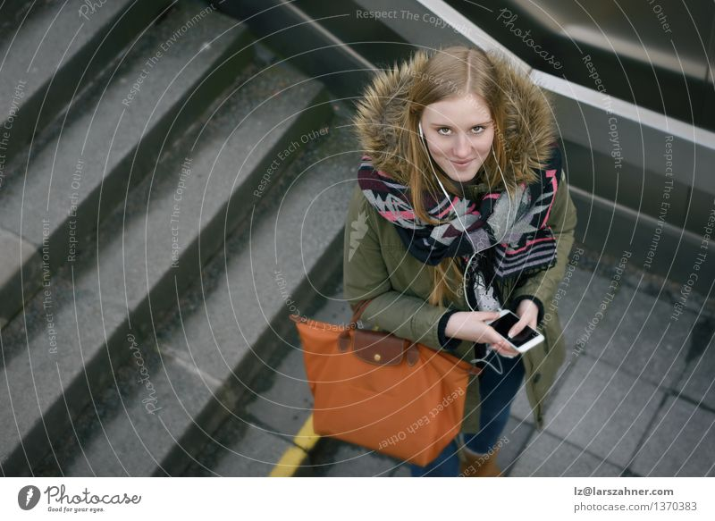 Stylish Woman in Winter Fashion at the Stairs Woman City Girl Winter Face Adults Style Lifestyle Stone Fashion Above Modern Technology Smiling Friendliness Telephone