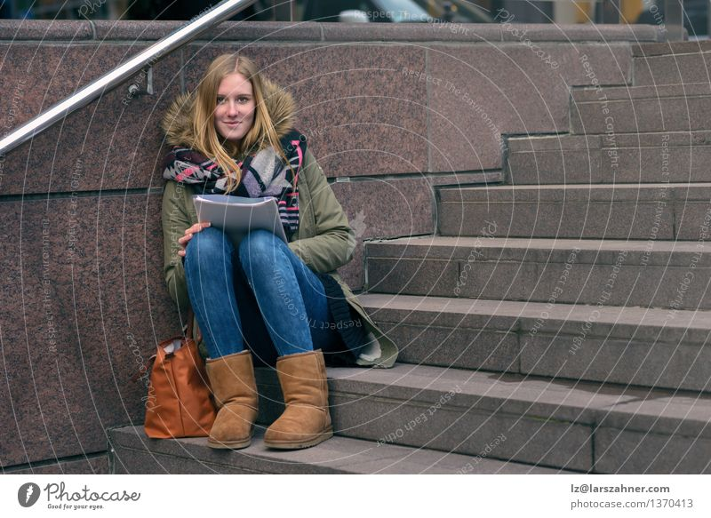 Young woman sitting reading on urban steps Human being Woman Youth (Young adults) Relaxation Girl Winter Face Adults Autumn Think Lifestyle School Stone Fashion Modern 13 - 18 years