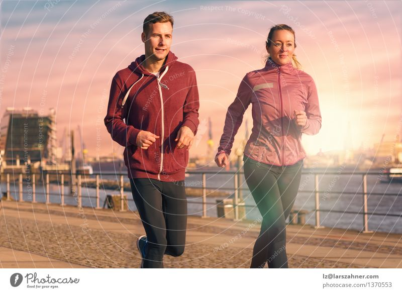 Young couple running on a seafront promenade Lifestyle Face Relaxation Sports Jogging Woman Adults Man Couple Partner 2 Human being 18 - 30 years