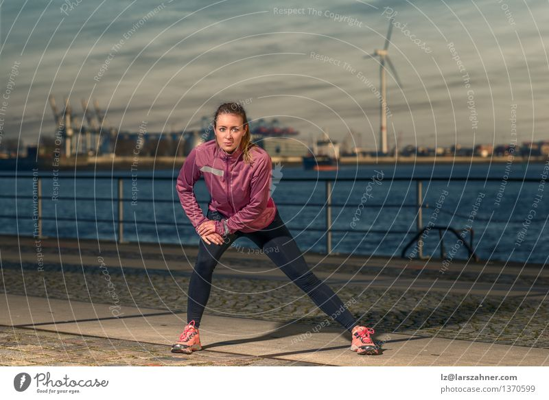 Young woman excercising at the waterfront Lifestyle Body Wellness Leisure and hobbies Sports Jogging Woman Adults Autumn Harbour Fitness Stand Athletic Sunset