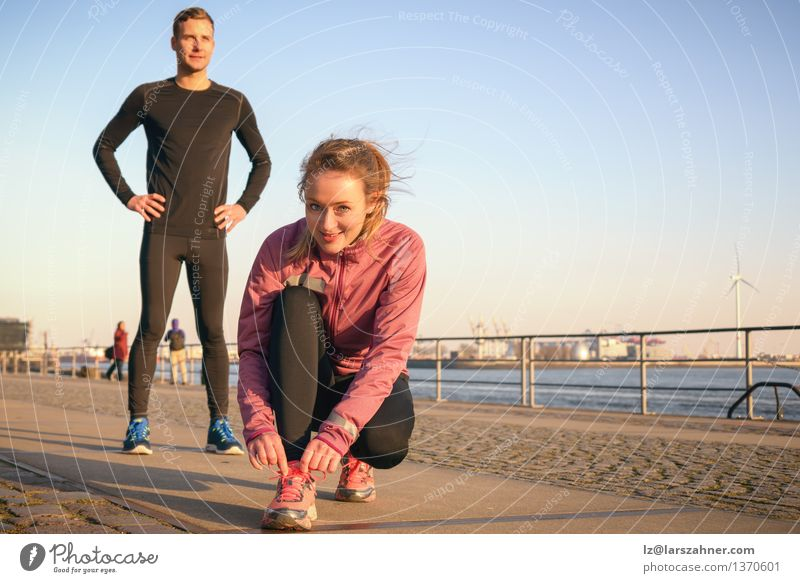 Sporty active couple on a seafront promenade Human being Woman Youth (Young adults) Man 18 - 30 years Adults Feminine Sports Lifestyle Couple Work and employment Masculine Action Footwear Smiling Fitness