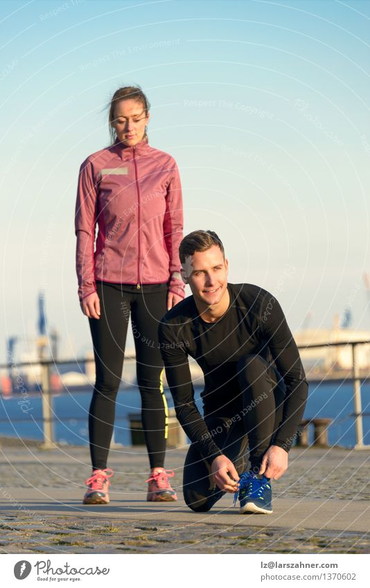 Couple in Fitness Attire Ready for Outdoor Workout Human being Woman Youth (Young adults) Man 18 - 30 years Adults Feminine Sports Lifestyle Work and employment