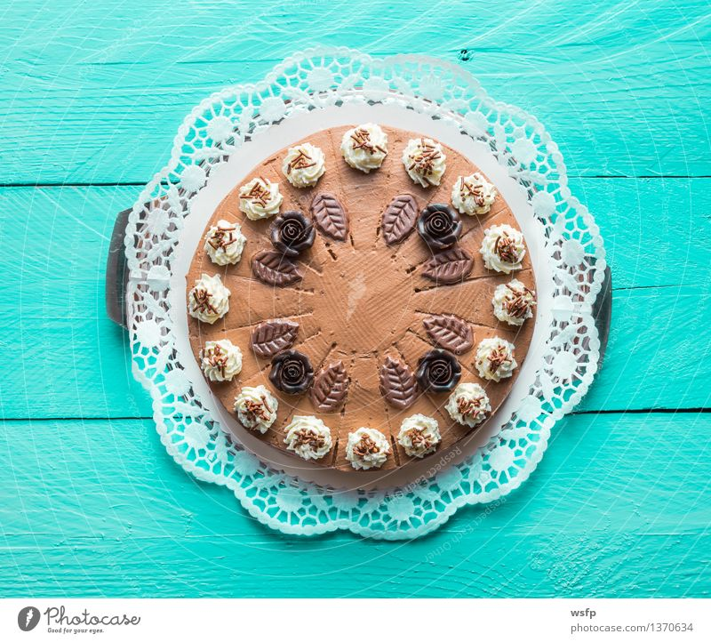 Chocolate cream cake on turquoise wood with cake lace Cake Dessert Wood Turquoise chocolate cream cake Gateau foam pastries Cream cake top Baked goods