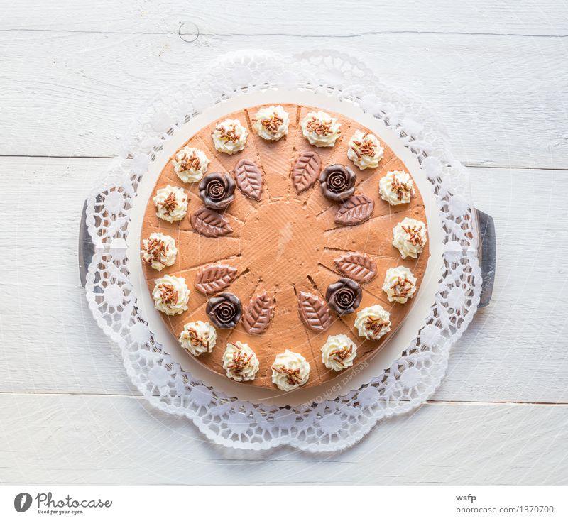 Chocolate cream cake on white wood with cake lace Cake Dessert Wood White chocolate cream cake Gateau foam pastries Cream cake top Baked goods sponge cake