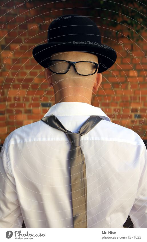front and rear Lifestyle Style Masculine Man Adults Head Wall (barrier) Wall (building) Shirt Tie Eyeglasses Hat Bald or shaved head Identity Unidentified Mask
