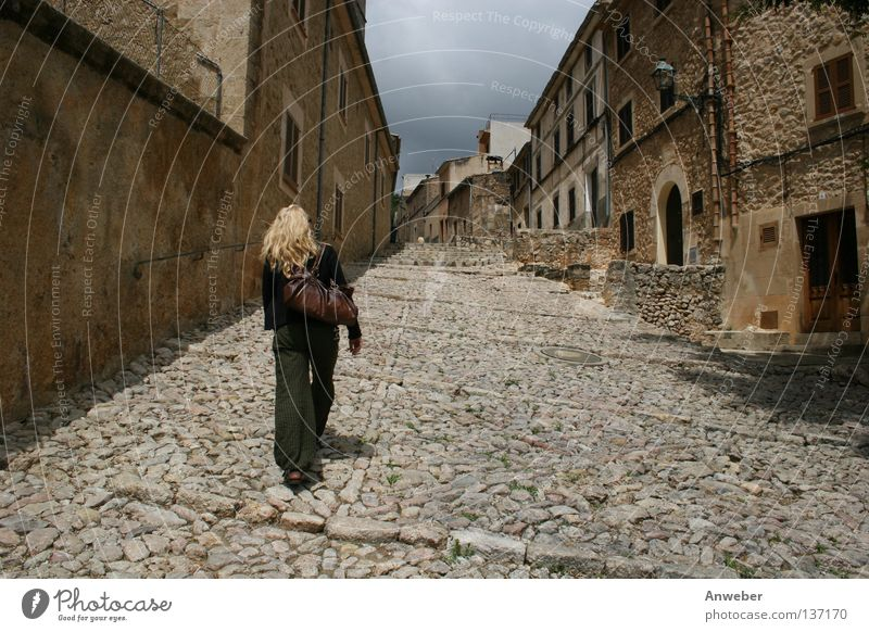 Woman Human being City Summer Vacation & Travel House (Residential Structure) Street Movement Hair and hairstyles Stone Lanes & trails Blonde Going Walking