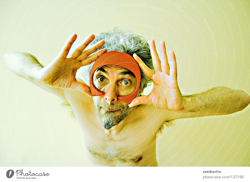Unclear situation Man Facial hair Dive Diving goggles Hand Looking Letters (alphabet) Typography Vitamin Characters Obscure Human being Face Eyes Nose Mouth