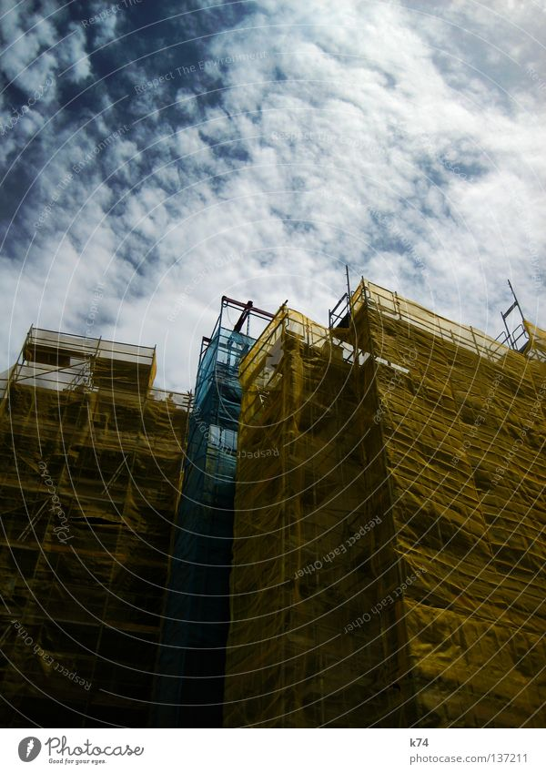 Blue City Yellow Facade Construction site Protection Transience Craft (trade) Hide Build Redecorate Scaffold Cover Redevelop Covers (Construction) Cover up