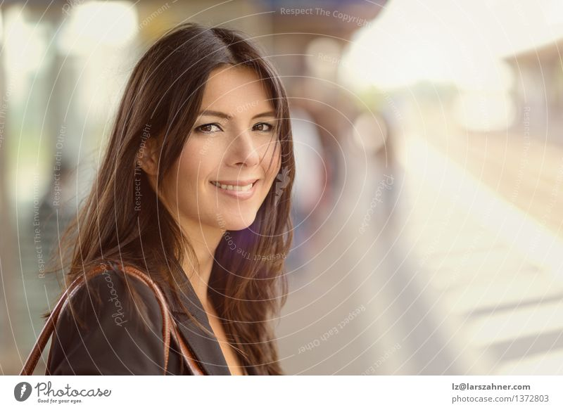 Smiling brunette woman Happy Face Woman Adults Railroad Brunette Wait background Commuter commuting Copy Space Eco-friendly Middle-aged 1 Person Station