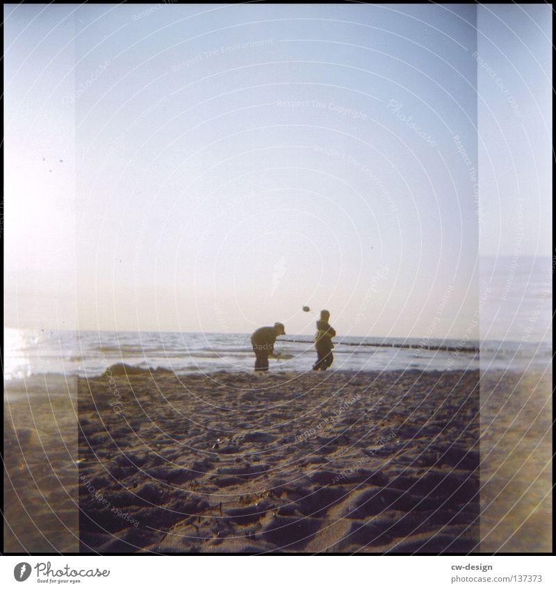 Human being Child Sky Man Water Summer Sun Colour Loneliness Joy Beach Black Environment Yellow Far-off places Dark