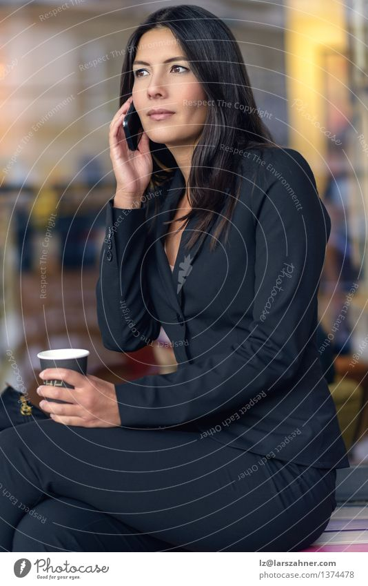 Smiling Businesswoman Listening on Mobile Phone Coffee Face Telephone Technology Woman Adults Brunette Paper Sit Wait Self-confident attractive break chatting