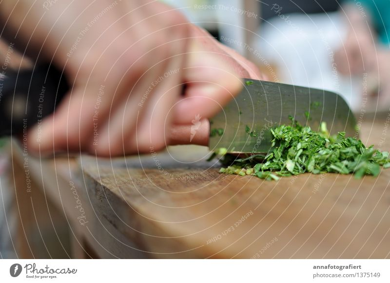 Cutting herbs Food Herbs and spices Knives Cook Fingers Garden Eating Brown Green Wood Wooden board Board Cooking Parsley Colour photo Close-up