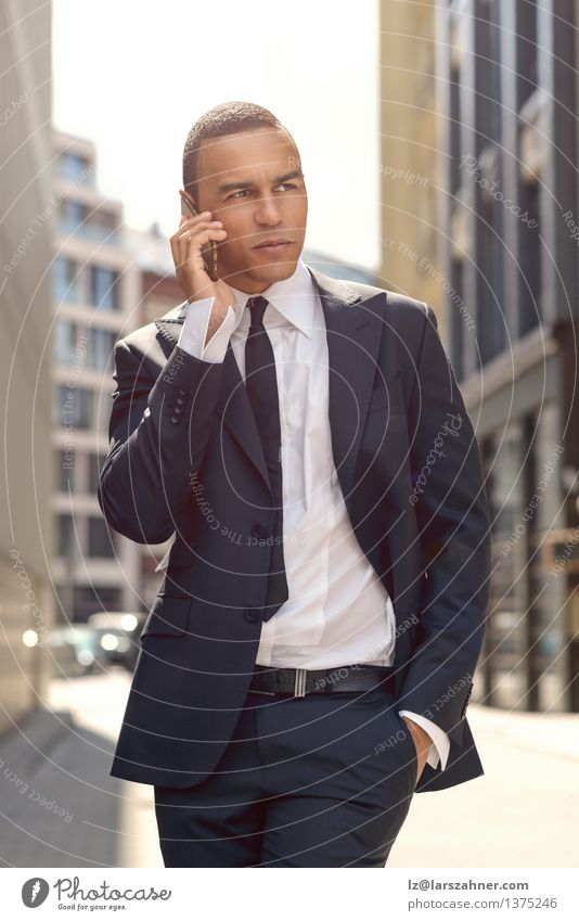 Young Businessman Talking on Phone In the Street Man City Calm Adults To talk Style Lifestyle Fashion Success Stand Technology Telephone Listening