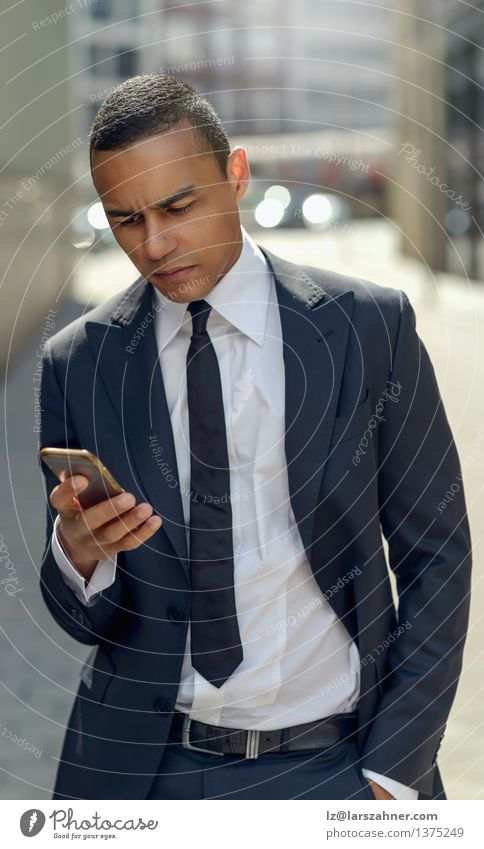 Businessman Texting on his Phone in the Street Style Reading Success Financial Industry Telephone PDA Technology Internet Man Adults Fashion Stand Modern Smart