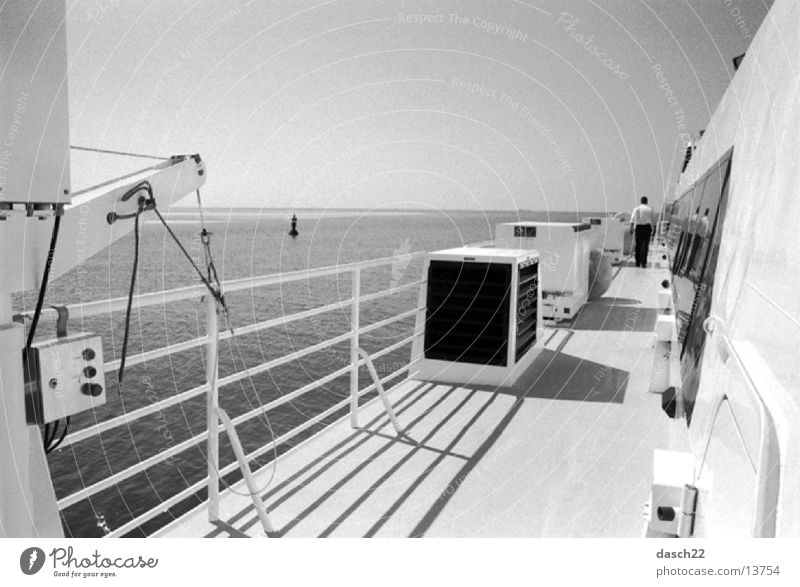 high sea Ferry Upper deck Railing Ocean Watercraft Waves Navigation Black & white photo Sun