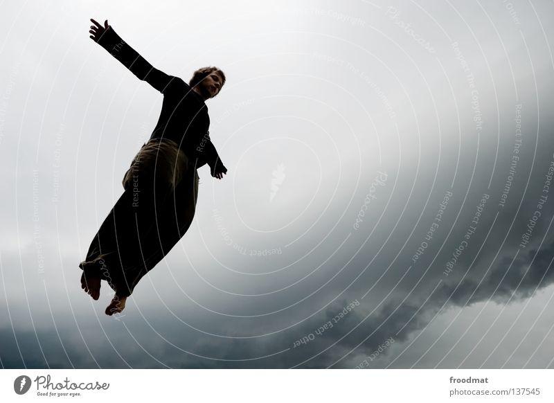 Human being Man Clouds Dark Freedom Jump Rain Bird Flying Aviation Symbols and metaphors Storm Hover Thunder and lightning God