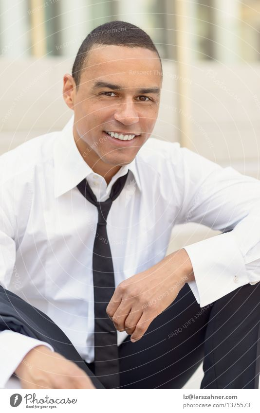 Attractive smiling businessman with a loosened tie Lifestyle Style Happy Face Summer Business Man Adults Teeth Shirt Suit Tie Smiling Laughter Sit
