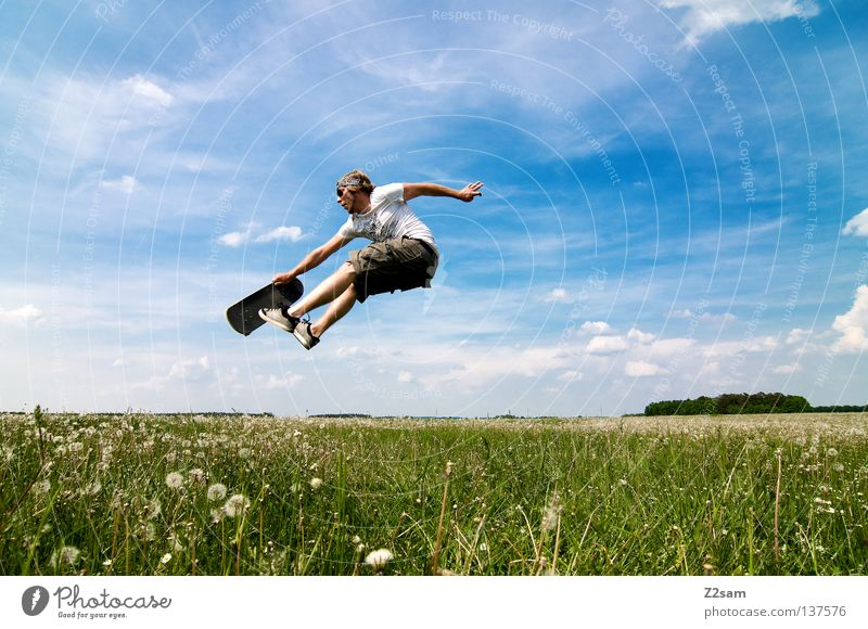 skate differently Jump Skateboarding Sports equipment Youth culture Action Grass Green Light blue Masculine Sky Summer Sunday Style Meadow Clouds Physics Juicy