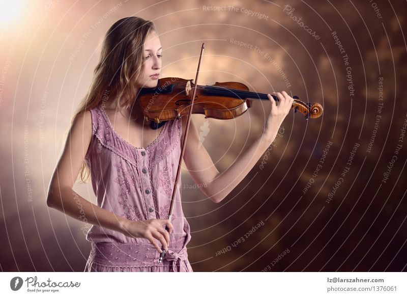 Pretty young violinist playing the violin Playing Music Academic studies Girl Woman Adults Youth (Young adults) Art Culture Concert Musician Violin artist bow