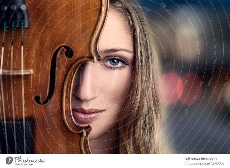 Pretty Young Woman Peeking Behind Violin Face Leisure and hobbies Music Profession Adults Musician Blonde Smiling Friendliness Blue attractive