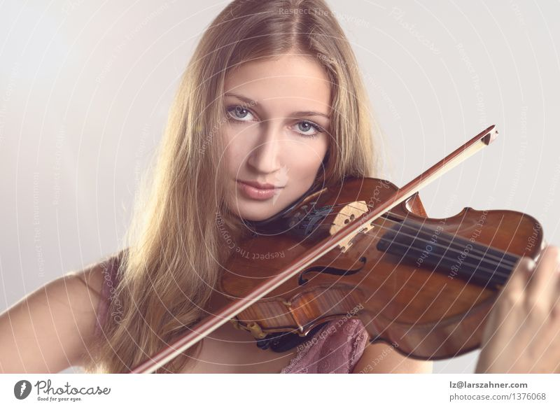 Pretty young violinist playing the violin Face Playing Music Academic studies Girl Woman Adults Youth (Young adults) Art Culture Concert Musician Violin