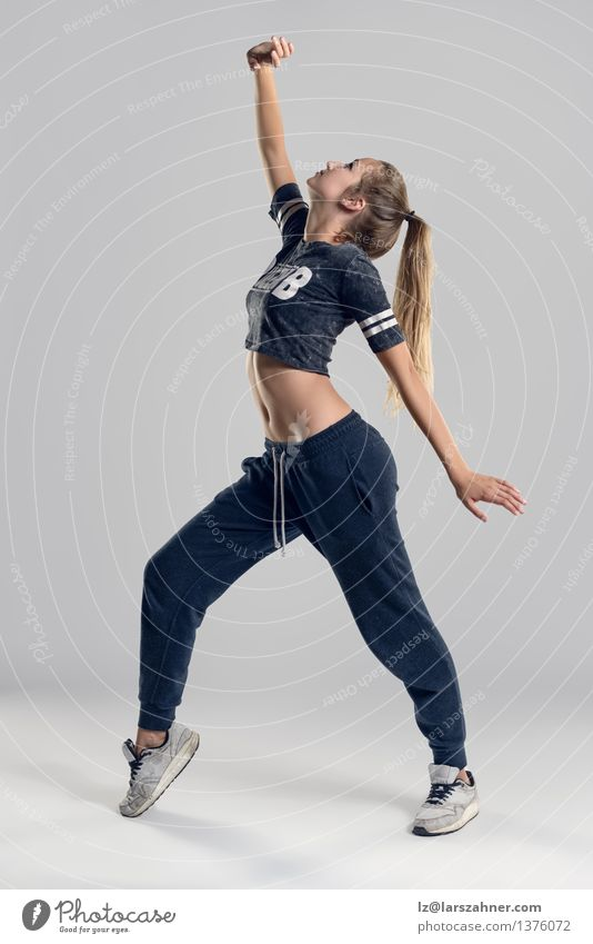 Female Hip Hop Dancer in Tiptoe Position Woman Adults Blonde Culture Thin Ballet Toes Entertainment Practice Hip-hop Sideways