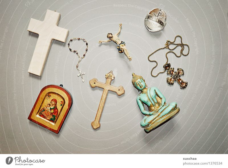 FAITH Religion and faith God Symbols and metaphors Crucifix Christian cross holy water Icons Rosary Buddha Jesus Christ Catholicism Christianity Buddhism