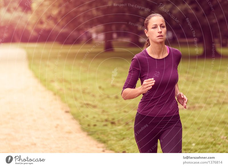 Athletic Woman in Running Exercise at the Park Nature Summer Adults Sports Action Copy Space Earnest Runner Determination Jogging Practice Jogger