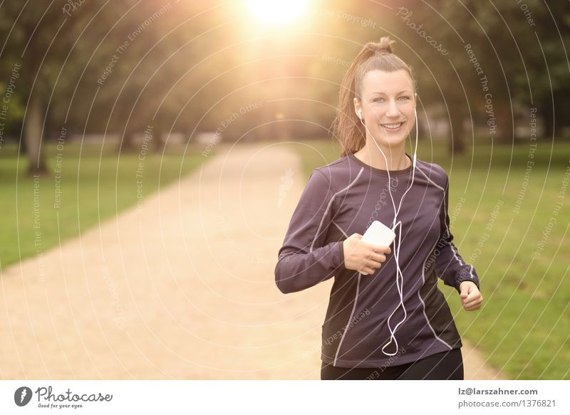 Pretty Woman Jogging at the Park with Headphones Colour Summer Landscape Leaf Adults Street Autumn Movement Sports Happy Lifestyle Fresh Action Music
