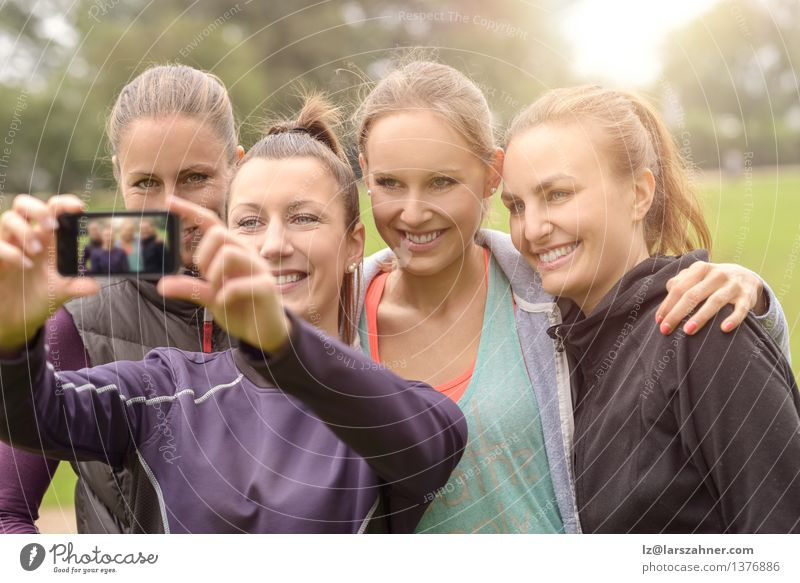 Happy Women Taking Selfie After Outdoor Exercise Leisure and hobbies Summer Sports Telephone PDA Camera Technology Woman Adults Friendship Group Grass Park