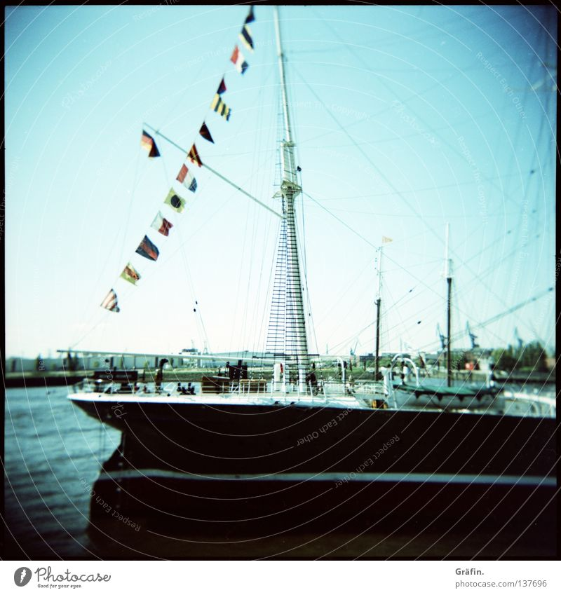 Corner heff moal'n Hamborger Veermaster see Holga Clouds Watercraft Sailing ship Cargo-ship Steel Stern Port side Starbord Windjammer Flag Captain Driving