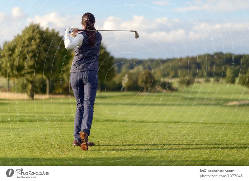 Female golfer striking golf ball Woman Relaxation Landscape Adults Sports Playing Lifestyle Leisure and hobbies Modern Action Copy Space Stand Club Disco Golf