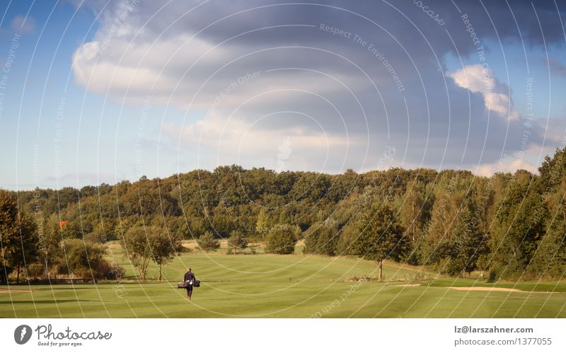 Golfer wallking on golf course Nature Man Summer Relaxation Landscape Adults Sports Playing Lifestyle Leisure and hobbies Action Carrying Course (flight)