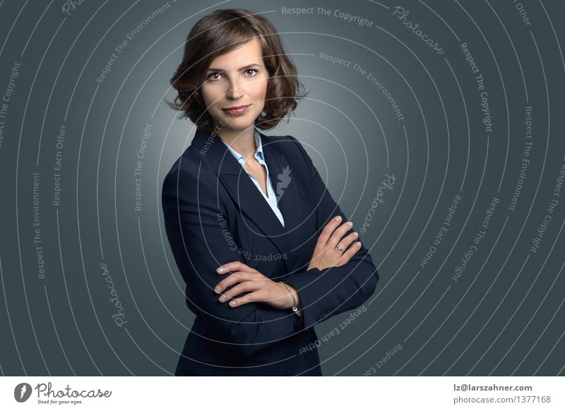 Attractive businesswoman with curly brown hair Face Decoration Business Woman Adults Suit Brunette Smiling Friendliness applicant Businesswoman Copy Space Curly