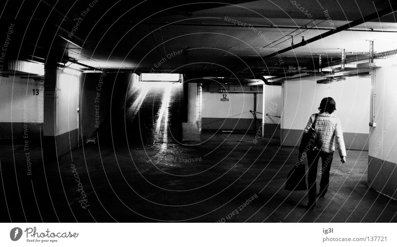 underground movement Parking lot Underground garage Parking level Dangerous Watchfulness Theft Woman Human being Eerie Mystic Loneliness Brave Robbery Possible