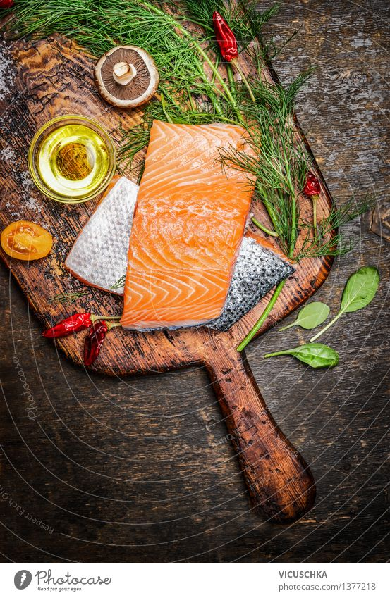 Salmon fillet on old cutting board with oil, herbs and spices Food Fish Herbs and spices Cooking oil Nutrition Lunch Dinner Banquet Organic produce