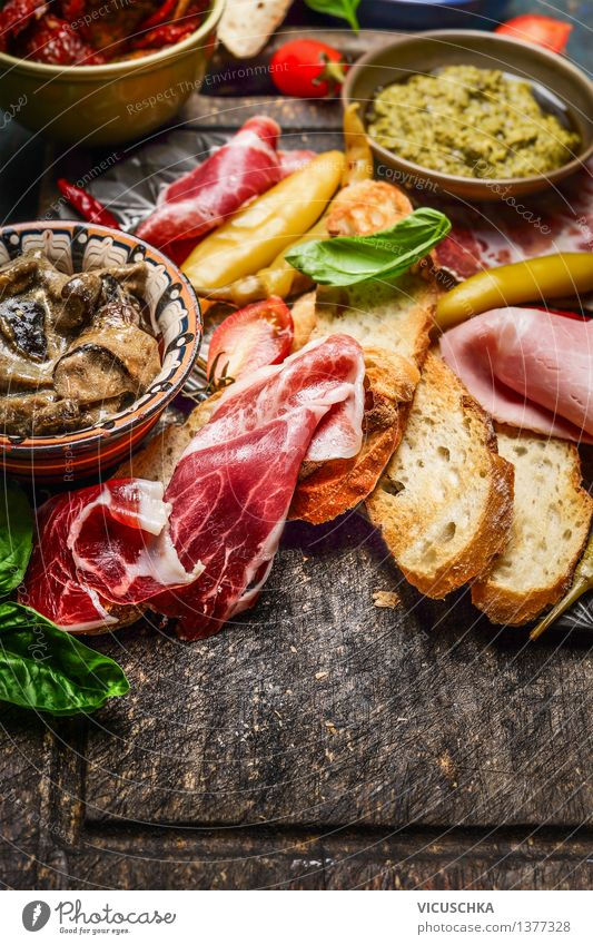 Italian specialities for antipasti Food Meat Sausage Vegetable Lettuce Salad Bread Herbs and spices Cooking oil Nutrition Lunch Buffet Brunch Banquet
