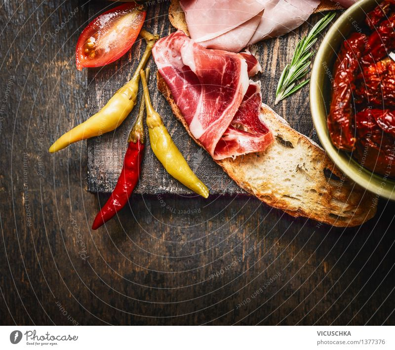 Bruschetta with Italian ham and antipasti Food Meat Sausage Vegetable Lettuce Salad Herbs and spices Breakfast Lunch Banquet Italian Food Style Design Table