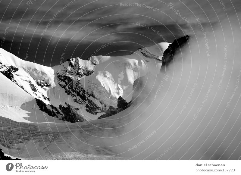 The mountain is calling!???? Clouds Peak Go up Dramatic Black White Switzerland Bernese Oberland Hiking Back-light Mountaineering Dangerous Leisure and hobbies