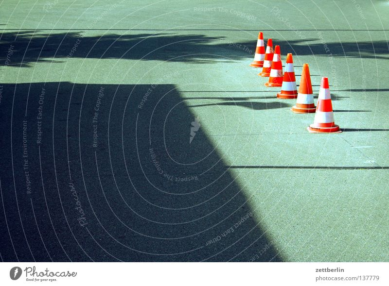 pylons Hat Traffic cone Road traffic Diversion Rule Road sign Behind one another Reddish white Asphalt Summer Traffic infrastructure Communicate Street sign